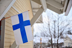 FInnish house with a flag Royalty Free Stock Image
