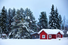 Finnish house. Red wooden Finnish house in winter forest covered with snow Royalty Free Stock Images