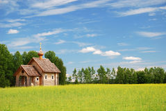 Finnish landscape with small wooden church. Royalty Free Stock Photos