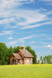 Finnish landscape with small wooden church. Stock Image