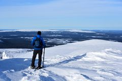 Finnish Lapland. Snow shoeing at fell Ylläs in Finnish Lapland, Finland royalty free stock photo