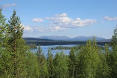 Lapland summer lake scenery. Finnish Lapland summer lake scenery with Pallastunturi fells on the horizon royalty free stock photo