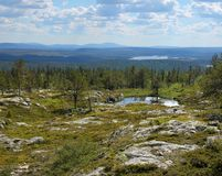 Finnish Lapland summer scenery from fell Sarkitunturi. Finnish Lapland summer scenery from fell Särkitunturi with fell Yllästunturi on the horizon royalty free stock photo