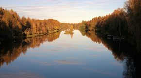 Finnish nature. Autumnal forest reflectied in lake Royalty Free Stock Photo