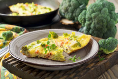Finnish, omelet with broccoli, farel, potatoes and onions. Rustic style. Stock Photos