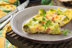 Finnish, omelet with broccoli, farel, potatoes and onions. Rustic style. Selective focus Royalty Free Stock Photos