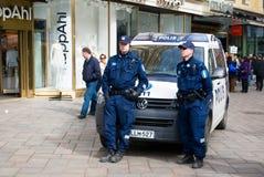 Finnish police. Two finnish policemen keep order. Helsinki. Finland Royalty Free Stock Photo