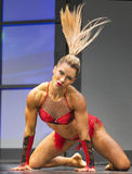 Finnish Pro Fitness Star Hair-Raising Performance. Finnish professional fitness star Piia Pajunen displays her winning form during her stage performance at the Royalty Free Stock Image
