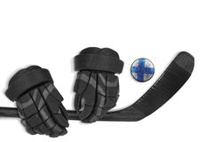 Finnish puck, gloves and hockey stick Royalty Free Stock Photo