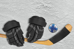 Finnish puck, stick and gloves Royalty Free Stock Photography