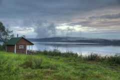 Finnish-Russian village sauna on the river bank Stock Images