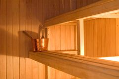 Finnish Sauna. This is a view of a finnish-type sauna with bucket for throwing water on the furnace Royalty Free Stock Photo