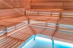 Finnish sauna. Benches, lighting and wall covering for sauna. Finnish sauna. Benches, lighting and wall Royalty Free Stock Photography