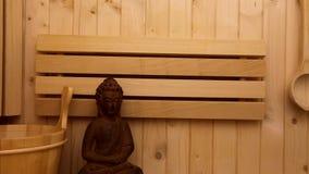 Finnish sauna and buddha figure stock video footage