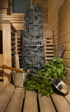 Finnish sauna, stove and accessories Royalty Free Stock Photography
