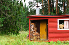 Finnish sauna with wood. Finnish sauna  in the forest Royalty Free Stock Photo