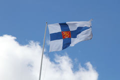 Finnish State Flag against blue sky. N royalty free stock photos