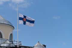 Finnish state flag in half mast on top of the main library of the University of Helsinki. Helsinki, Finland. 25th May, 2017. The state funeral of the former stock image