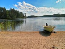 Finnish summer in Saimaa. Beautiful landscape in Saimaa lake, Finland.Calm and cloudy summer day royalty free stock photo