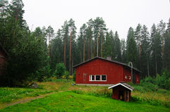 Finnish traditional cottage under rain Stock Photo