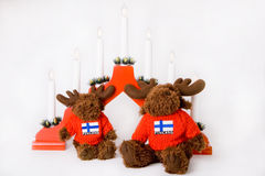 Finnish traditional reindeer and Christmass red la. Mp decoration on white background stock photography
