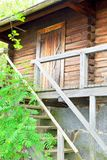 Finnish traditional sauna, door and stairs Royalty Free Stock Photo