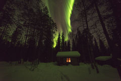 Finnish wilderness hut and auroras Royalty Free Stock Photography