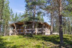 Finnish wooden loghouse in the forest of Lapland. Europe Stock Photos
