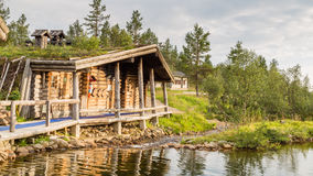Finnish Wooden Loghouse In Lapland Europe Stock Photos