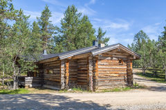 Finnish wooden loghouse Lapland. Finnish wooden loghouse in the forest of Lapland Europe Stock Photo