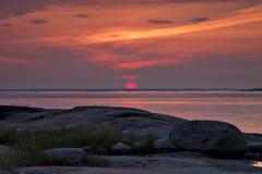 Finnland: Roter Sonnenuntergang Stockbild