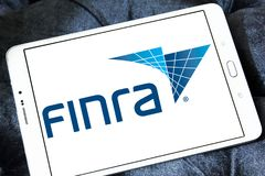 FINRA corporation logo. Logo of FINRA corporation on samsung tablet. FINRA is a private corporation that acts as a self regulatory organization SRO. FINRA is the royalty free stock image