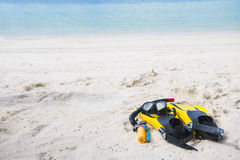 Fins, diving masks and camera for underwater on the beach Royalty Free Stock Image