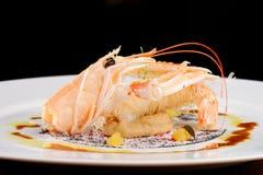 Fint äta middag, scampi-/Norge hummer på auberginekräm Royaltyfri Bild