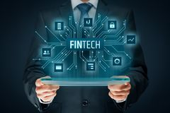 Fintech and financial technology. Fintech financial technology concept. Business person with tablet and fintech illustration Royalty Free Stock Image