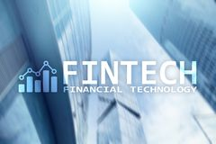 FINTECH - Financial technology, global business and information Internet communication technology. Skyscrapers background. Hi-tech business concept Royalty Free Stock Photos