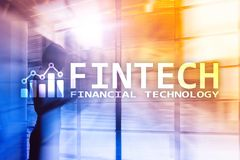 FINTECH - Financial technology, global business and information Internet communication technology. Skyscrapers royalty free stock image