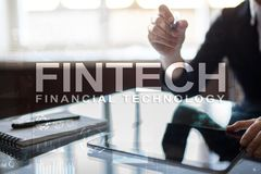 Fintech. Financial technology text on virtual screen. Business, internet and technology concept. Fintech. Financial technology text on virtual screen. Business Royalty Free Stock Image