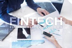 Fintech. Financial technology text on virtual screen. Business, internet and technology concept. Fintech. Financial technology text on virtual screen. Business Royalty Free Stock Photos
