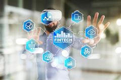 Fintech. Financial technology text on virtual screen. Business, internet and technology concept. Fintech. Financial technology text on virtual screen. Business Stock Photos