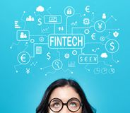 Fintech theme with young woman Royalty Free Stock Images