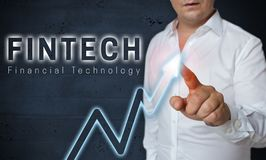 Fintech touchscreen is operated by man concept royalty free stock photography