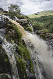 Fintry Loup Waterfall. The top section of the Fintry Loup, a 90-foot waterfall that cascades down vast stone steps Stock Photos