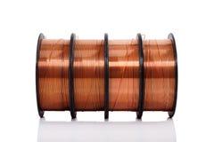 Fio de soldadura de cobre nos carretéis isolados Foto de Stock