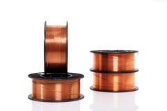 Fio de soldadura de cobre nos carretéis isolados Fotografia de Stock Royalty Free