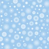 Fiocchi di neve bianchi su una priorità bassa blu. illustrazione di stock