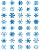 Fiocchi di neve blu differenti Fotografie Stock