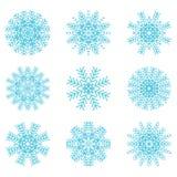Fiocchi di neve blu messi Illustrazioni di vettore Immagine Stock Libera da Diritti