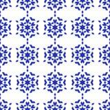 Fiocchi di neve blu su una priorità bassa bianca Fotografia Stock
