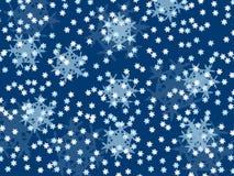 Fiocchi di neve di caduta, piccolo e grande su un fondo blu Fotografia Stock Libera da Diritti